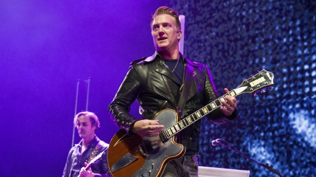 Josh Homme of Queens of the Stone Age performs at the 2017 KROQ Almost Acoustic Christmas at The Forum in Inglewood, Calif. on Saturday, Dec. 9, 2017. (Amy Harris/Invision/AP)