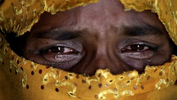 A woman identified as K25 cries as she recounts being gang raped by members of Myanmar's armed forces during an interview with The Associated Press in her tent in Kutupalong refugee camp in Bangladesh on Tuesday, Nov. 21, 2017. (AP Photo/Wong Maye-E)