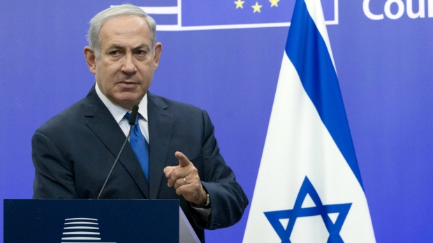 Israeli Prime Minister Benjamin Netanyahu addresses a media conference with European Union High Representative Federica Mogherini at the EU Council building in Brussels on Monday, Dec. 11, 2017. (AP Photo/Virginia Mayo)