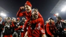 Toronto FC Sebastian Giovinco jumps on Jonathan Osorio after defeating the Seattle Sounders to win the MLS Cup Final in Toronto on Saturday, December 9, 2017. THE CANADIAN PRESS/Mark Blinch