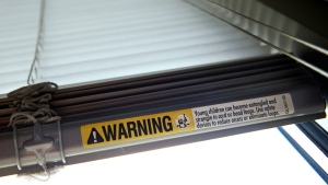 This  May 6, 2015 file photo shows a warning label of strangulation risks from mini blind cords in Washington.  (AP /Jacquelyn Martin)
