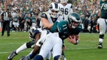 Philadelphia Eagles quarterback Carson Wentz (11) gets tackled during the second half of an NFL football game against the Los Angeles Rams on Dec. 10, 2017, in Los Angeles. (AP Photo/Mark J. Terrill)