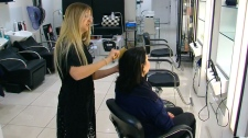 Hairdresser Alexis Rushlow with one of her clients.