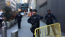 Police block off a sidewalk while responding to a report of an explosion near Times Square on Monday, Dec. 11, 2017, in New York. (AP Photo/Mark Lennihan)