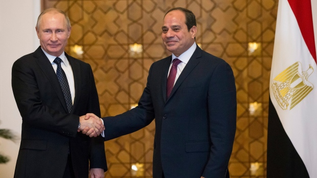 Russian President Vladimir Putin, left, and Egyptian President Abdel-Fattah El-Sissi, shake hands during their meeting in Cairo, Egypt, Monday, Dec. 11, 2017. (AP Photo/Alexander Zemlianichenko)