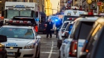 Police block a street by Port Authority Bus Terminal near New York's Times Square following an explosion on Monday, Dec. 11, 2017. Police say the explosion happened in an underground passageway under 42nd Street between Seventh and Eighth Avenues. (AP Photo/Andres Kudacki)