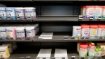 Baby milk boxes have been removed from shelves in a drugstore in Anglet, southwestern France, Monday, Dec.11, 2017. (AP Photo/Bob Edme)