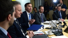 Finance Minister Bill Morneau, centre, speaks as he meets with his provincial and territorial counterparts on Parliament Hill in Ottawa on Monday, Dec. 11, 2017. THE CANADIAN PRESS/Sean Kilpatrick