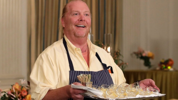 American chef Mario Batali holds a tray of pasta during a preview in advance of the State Dinner in honor of the Official Visit of Italian Prime Minister Matteo Renzi and his wife Agnese Landini in the State Dining Room of the White House in Washington, Monday, Oct. 17, 2016. (AP Photo/Carolyn Kaster)