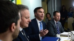Finance Minister Bill Morneau, centre, speaks as he meets with his provincial and territorial counterparts on Parliament Hill in Ottawa on Monday, Dec. 11, 2017. (Sean Kilpatrick / THE CANADIAN PRESS)