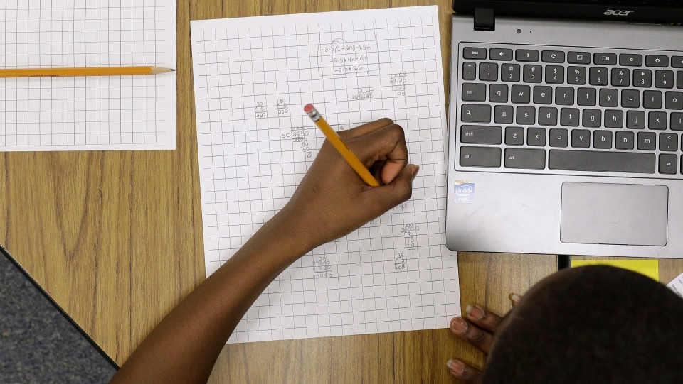 A 12-year-old student works on math problems in Annapolis, Md., in this Feb. 12, 2015 file photo. (AP/Patrick Semansky)