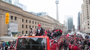 Toronto FC captain Michael Bradley (right) and Sebastian Giovinco stand with the MLS Trophy as Toronto FC celebrates their victory in the MLS Cup final with a parade through downtown Toronto on Monday, Dec. 11, 2017. (THE CANADIAN PRESS/Chris Young)