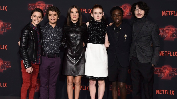 """Noah Schnapp, from left, Gaten Matarazzo, Millie Bobby Brown, Sadie Sink, Caleb McLaughlin and Finn Wolfhard arrive at the premiere of """"Stranger Things"""" season two on Oct. 26, 2017. (Jordan Strauss / Invision / AP)"""