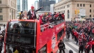 Toronto FC captain Michael Bradley (right) stands at the front of the bus alongside Sebastian Giovinco with the MLS Trophy as Toronto FC celebrates their victory in the MLS Cup final with a parade through downtown Toronto on Monday, Dec. 11, 2017. THE CANADIAN PRESS/Chris Young