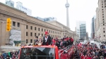 Toronto FC captain Michael Bradley (right) and Sebastian Giovinco stand with the MLS Trophy as Toronto FC celebrates their victory in the MLS Cup final with a parade through downtown Toronto on Monday, December 11, 2017. THE CANADIAN PRESS/Chris Young