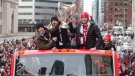 Toronto FC's Sebastian Giovinco (left) Victor Vazquez (centre) and Michael Bradley hold the MLS Trophy as they team celebrates their victory in the MLS Cup final with a parade through downtown Toronto on Monday, December 11, 2017. THE CANADIAN PRESS/Chris Young