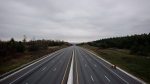A fatal vehicle pileup north of Toronto closed a stretch of Highway 400 in both directions south of Barrie, Ont. on Wednesday, Nov. 1, 2017. (THE CANADIAN PRESS/Christopher Katsarov)