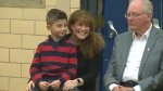 Ronan, 6, and his mother Denise at an assembly at St. Angela Catholic School Monday, December 11, 2017.
