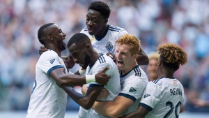 Vancouver Whitecaps' Bernie Ibini, from left, Tony Tchani, Alphonso Davies, Tim Parker and Yordy Reyna celebrate Tchani's tying goal against the Columbus Crew during the second half of an MLS soccer game in Vancouver on September 16, 2017. (THE CANADIAN PRESS / Darryl Dyck)