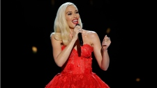 """This image released by NBC shows singer Gwen Stefani in her Christmas special, """"Gwen Stefani's You Make it Feel Like Christmas,"""" airing Dec. 12 at 9 p.m. ET on NBC. (Paul Drinkwater / NBC via AP)"""