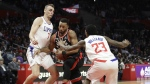 Toronto Raptors' Norman Powell, centre, is defended by Los Angeles Clippers' Sam Dekker, left, and Lou Williams during the second half of an NBA basketball game in Los Angeles on Monday, Dec. 11, 2017. (AP Photo/Jae C. Hong)