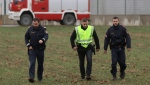 Police officers walk outside a gas plant after an explosion occurred near Baumgarten an der March, Austria, Tuesday, Dec. 12, 2017. (AP Photo/Ronald Zak)
