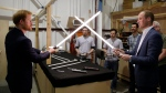 In this file photo Prince William, right, and Prince Harry use lightsabers during a tour of the Star Wars sets at Pinewood studios in Iver Heath, west London, Tuesday April 19, 2016. (Adrian Dennis/Pool via AP)