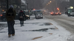 Bare patches of sidewalk were easily visible on Monkland Ave. a few hours after snow started to fall on Dec. 12, 2017 (CTV Montreal/JL Boulch)