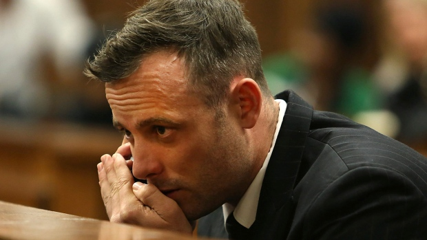 In this June 15, 2016 file photo Oscar Pistorius speaks on a mobile phone in the High Court in Pretoria, South Africa, during his sentencing hearing for murdering girlfriend Reeva Steenkamp. (AP Photo/Alon Skuy, Pool via AP, File)