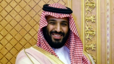 FILE - In this July, 23, 2017 file photo, Saudi Crown Prince Mohammed bin Salman poses while meeting with Turkey's President Recep Tayyip Erdogan in Jiddah, Saudi Arabia. Saudi Arabia announced on Monday, Dec. 11, 2017 it will allow movie theaters to open in the conservative kingdom next year, for the first time in more than 35 years, in the latest social push by the country's young crown prince. (Presidency Press Service/Pool Photo via AP, File)