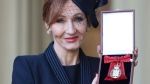 The author of the Harry Potter books, J.K. Rowling poses after she was made a Companion of Honour during an Investiture ceremony at Buckingham Palace in London, Tuesday Dec. 12, 2017. The Duke of Cambridge conducted the investiture for the honour. (Andrew Matthews/Pool via AP)