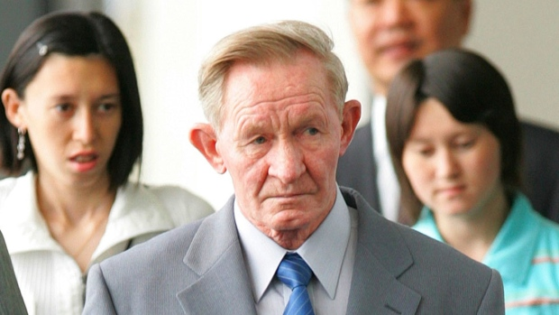 In this June 14, 2005 file photo, former U.S. Army deserter to North Korea, Charles Jenkins, together with his daughters Mika, rear left, and Brinda at Narita International Airport, east of Tokyo. (AP Photo/Itsuo Inouye, File)