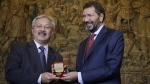 San Francisco Mayor Edwin Lee receives a commemorative medal of the city of Rome from Mayor Ignazio Marino, right, during a meeting in Rome Monday, July 20, 2015. (AP Photo/Gregorio Borgia)