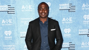 Marshall Faulk poses backstage at the Shining a Light: A Concert for Progress on Race in America held at the Shrine Auditorium on Wednesday, Nov. 18, 2015, in Los Angeles. (John Salangsang/Invision/AP)