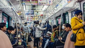 A digital match-making app being trialed this week on the metro aims to overcome two problems especially prevalent in Japan: passengers generally have their nose buried in their phones and talking is strictly frowned upon. (fotokon/IStock.com)