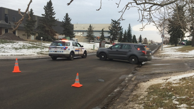 Strathcona County RCMP officers on the scene of a standoff in the industrial area of Sherwood Park Tuesday, December 12, 2017.