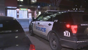 An EPS vehicle is seen outside of the U of A Hospital ER early Tuesday, December 12, 2017, after two males with apparent stab wounds showed up shortly before 12:30 a.m.