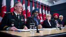 General Jonathan Vance, Chief of the Defence Staff (left to right) Defence Minister Harjit Sajjan, Carla Qualtrough, Minister of Public Services and Procurement, Navdeep Bains, Minister of Innovation, Science and Economic Development and Marc Garneau, Minister of Transport make an announcement on fighter jets at the National Press Theatre in Ottawa on Tuesday, Dec. 12, 2017. THE CANADIAN PRESS/Sean Kilpatrick