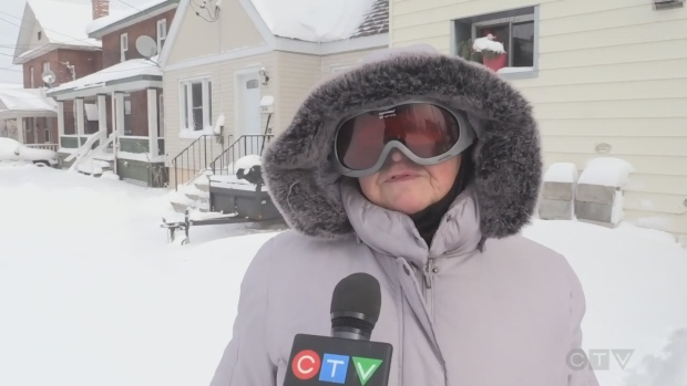 Mary Yackman of Sudbury shovels snow carefully