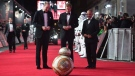 Prince William, Duke of Cambridge, left, and Prince Harry meet a BB8 Droid Sphero on the red carpet as they attend the European premiere of Star Wars: The Last Jedi, at the Royal Albert Hall, in central London, Tuesday, Dec. 12, 2017. (Eddie Mulholland/Pool Photo via AP)