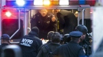Officials place suspect Akayed Ullah, on a stretcher, into the back of an ambulance on Eighth Avenue between 42nd Street and 43rd Street in New York on Monday, Dec. 11, 2017. (Craig Ruttle/Newsday)