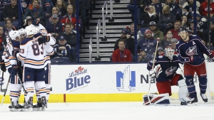 Edmonton Oilers players celebrate their goal against the Columbus Blue Jackets during the second period of an NHL hockey game in Columbus, Ohio on Tuesday, Dec. 12, 2017. (AP Photo/Jay LaPrete)