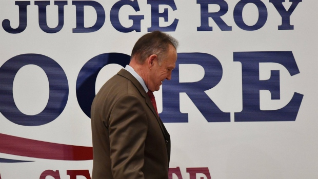 U.S. Senate candidate Roy Moore leaves the stage after speaking at the RSA activity center in Montgomery, Ala. on Tuesday, Dec. 12, 2017. (AP Photo/Mike Stewart)