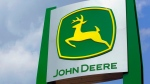 In this Monday, Aug. 31, 2015, file photo, the John Deere logo is seen at their equipment exhibit at the Farm Progress Show in Decatur, Ill. (Seth Perlman/AP Photo)