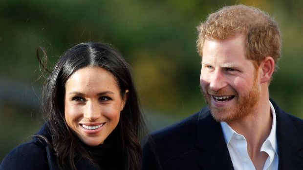 In this Dec. 1, 2017 file photo, Prince Harry and his fiancee Meghan Markle arrive at Nottingham Academy in Nottingham, England. (AP Photo/Frank Augstein, File)