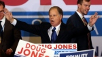 Democrat Doug Jones speaks Tuesday, Dec. 12, 2017, in Birmingham, Ala. In a stunning victory aided by scandal, Democrat Doug Jones won Alabama's special Senate election on Tuesday, beating back history, an embattled Republican opponent and President Donald Trump, who urgently endorsed GOP rebel Roy Moore despite a litany of sexual misconduct allegations. (AP Photo/John Bazemore)