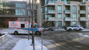 An ambulance at an Etobicoke building where police say a four-month-old baby and a man were stabbed on Dec. 13, 2017.