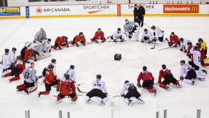 Canadian national junior team prospects gather at centre ice on the first day of selection camp for the 2018 World Junior Hockey Championship in St.Catharines, Ont., Tuesday, December 12, 2017. (THE CANADIAN PRESS/Aaron Lynett)
