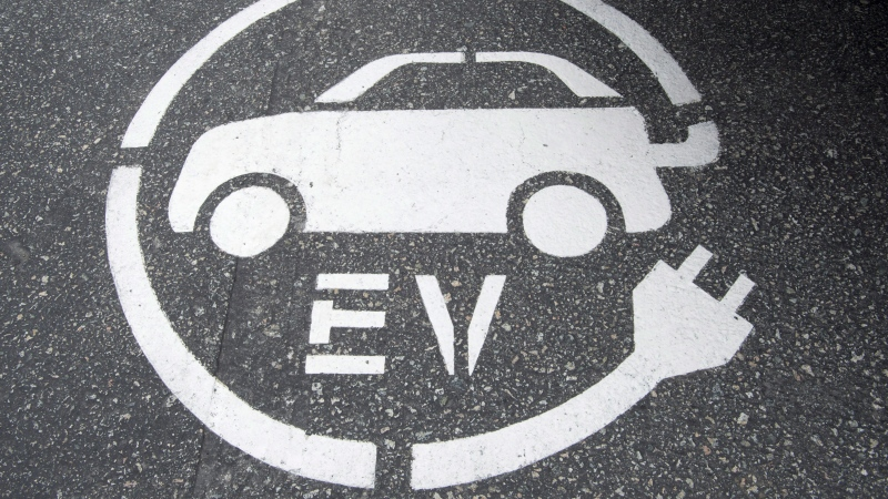 A electric vehicle charging sign is pictured in Squamish, B.C., on June, 1, 2016. (THE CANADIAN PRESS / Jonathan Hayward)