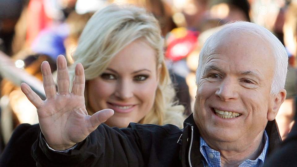 In this Oct. 30, 20087 file photo, Republican presidential candidate Sen. John McCain, R-Ariz., accompanied by his daughter Meghan McCain, waves to supporters as he enters a campaign rally in Defiance, Ohio. (AP Photo / Stephan Savoia)
